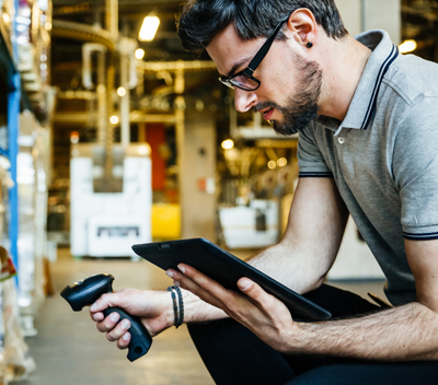 Man using technology to manage inventory